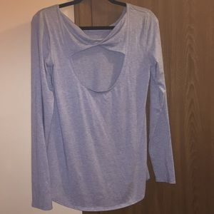 Pretty baby blue top by Athleta. Size S